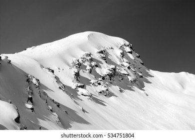 Black and white view on off-piste slope in winter mountains after snowfall. Mount Cheget. Caucasus Mountains. Elbrus region.