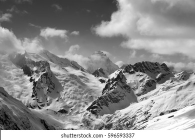 Black and white view on winter mountains in snow. Caucasus Mountains, region Dombay. Mount Sulahat.
