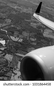 Black & white view out the airplane window.