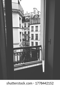 Black and white view of Parisian buildings through a hotel window