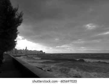 Black and white view of the sunset in the old town of Molfetta, Apulia region, southern Italy