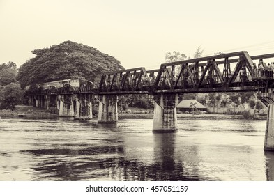 Black and white vintage photo style trains for travel running on the old bridge over the River Kwai is a historical attractions during World War 2 the famous of Kanchanaburi Province in Thailand