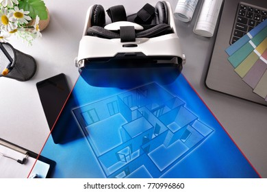 Black and white virtual reality glasses on decorator office table with interior 3d representation. Horizontal composition. Top view