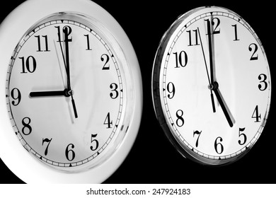 Black and White wall clocks showing the typical 9 to 5 work day