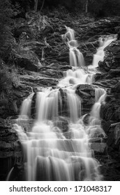 black and white waterfall with many cascades
