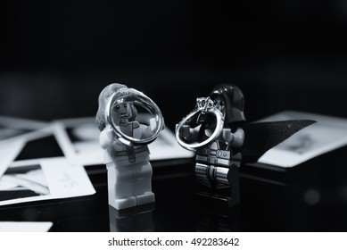 Black and White Wedding Rings on Hand Toy