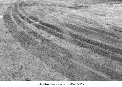 Black and White Wheel tracks on dirt