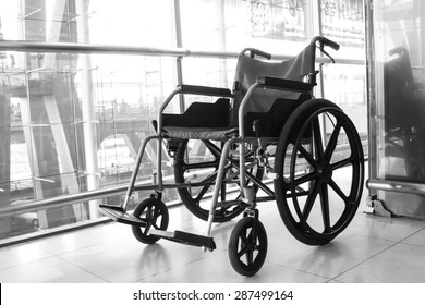 Black and white Wheelchair service in airport terminal