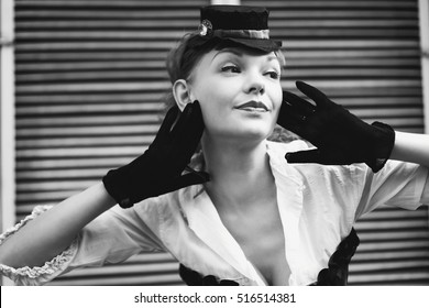 Black and white woman portrait, black gloves and little hat, headshot