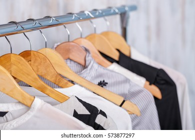 black and white womens clothes on hangers on rack in fashion sto