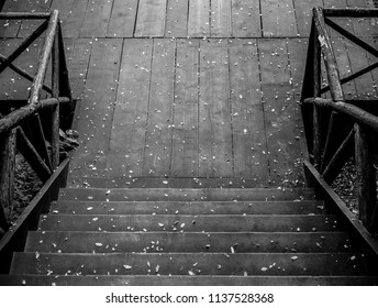 Black and white wooden steps and deck