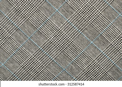 Black and white wool twill pattern. Black and white with blue houndstooth pattern in squares. Woven dogstooth check design as background.