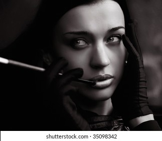 Black and white young woman in gloves smoking sigarette