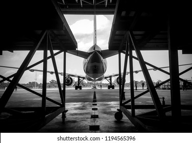 Black and white,too soft photo of Aircraft push back into the  maintenance area.Aircraft(airplane)in aircraft hangar for maintenance service check by aircraft technician.Maintenance before flight.
