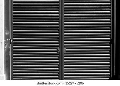 Black window shutter on the wall.