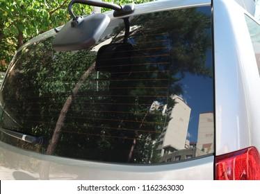 black window silver car