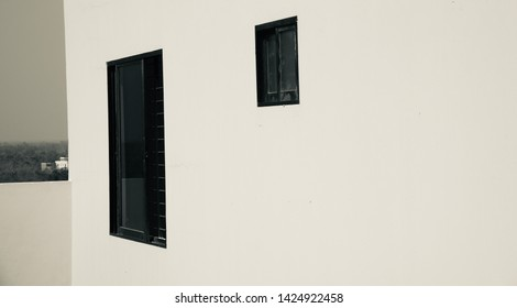 Black windows of a concrete building unique black and white photo