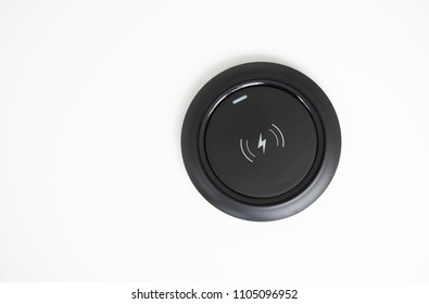 Black Wireless charger on the white screen