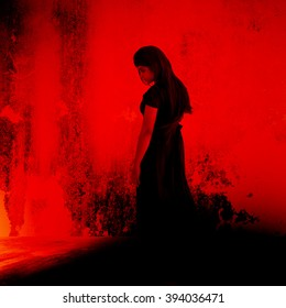 Black witch,Mysterious girl in black dress standing in abandon place,Horror background for halloween concept and movie poster project