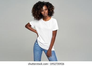 Black woman with afro hair wear classic outfit isolated on gray background