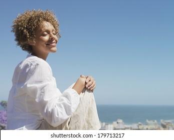 Black woman against blue sky