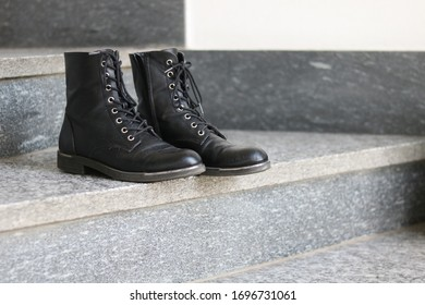 Black Woman Boots on Staircase Steps