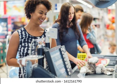 Black woman buying goods in a grocery store