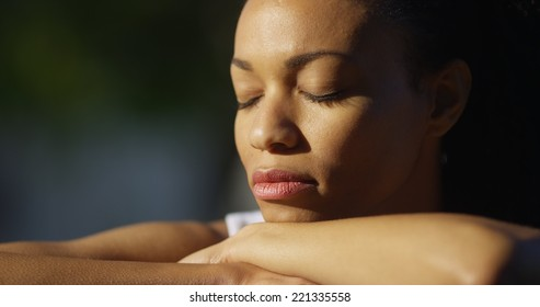 Black woman crying outdoors