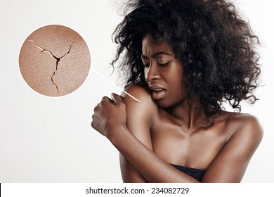 black woman with a dry skin. Concept with a loupe, showing cracked skin