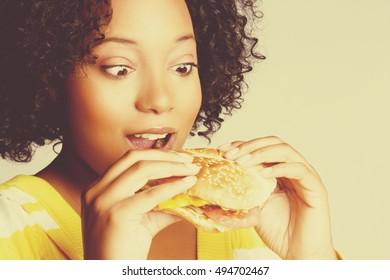 Black woman eating burger sandwich food