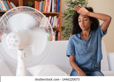 Black woman feeling hot because summer heat wave