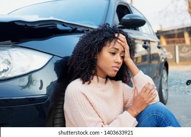 Black woman feeling pain after car crash