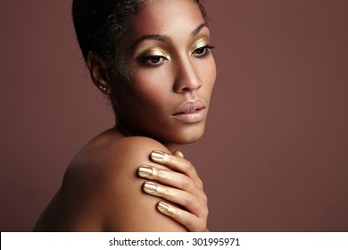 black woman with a golden makeup
