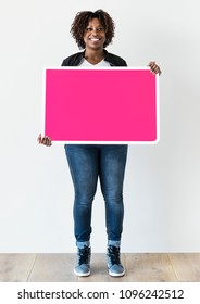 Black woman holding blank board