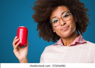 black woman holding a coke
