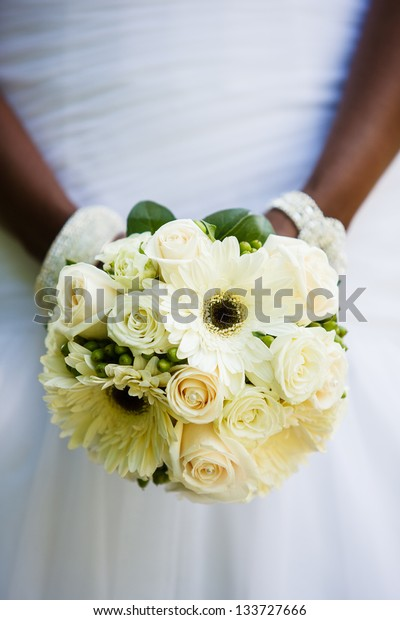 Black woman holding a wedding bouquet