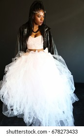 black woman in leather jacket and tulle skirt