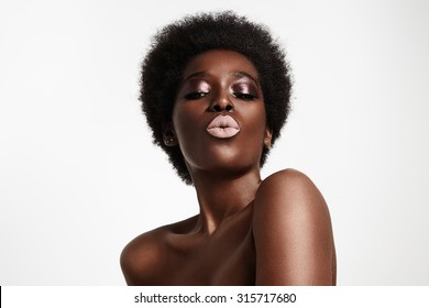 black woman with light pink lips sending kiss