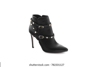Black Woman Long Boot Shoe Isolated on White Background. Fashionable boots for women may exhibit all the variations seen in other fashion footwear. Tapered or spike heels, platform soles, pointed toes