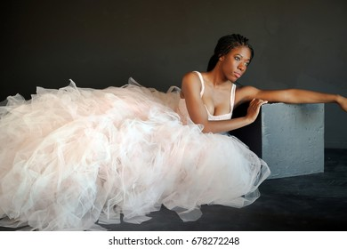 black woman in long tulle skirt