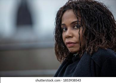 Black woman portrait with urban background