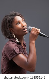 Black Woman Singing Into Microphone