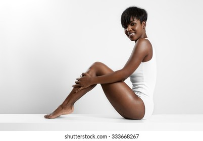 black woman sitting on a white table