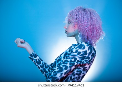 black woman with stylish afro hairstyle on animal print clothes