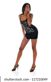 Black Woman wearing a dark dress and high heels isolated on a white background
