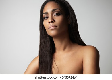 black woman's portrait with a straight hair