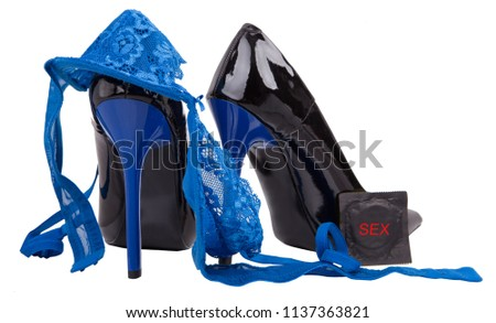 61c04223080 Black women shoes on white background. High heels and Sexy underwear.