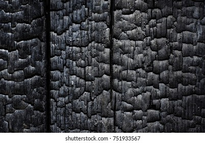 black wood background, after a fire
