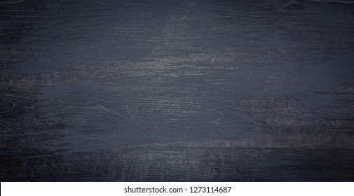 Black Wood Board Background. Wooden grunge Texture. Painted Dark Wood Surface Table. Wide Angle Wallpaper or Web banner With Copy Space for design