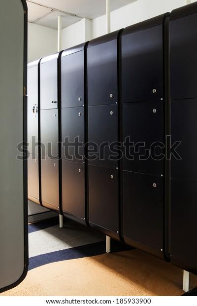 Black wood locker room at office.